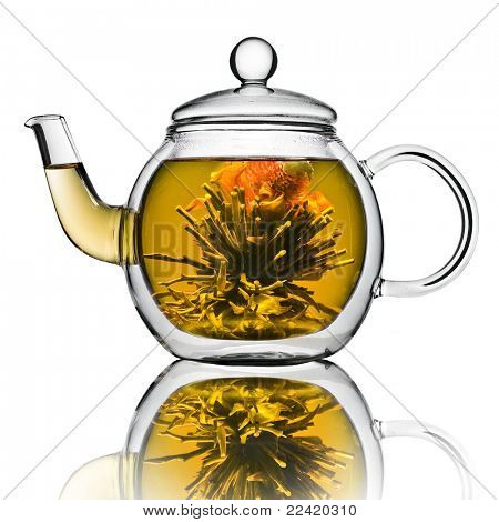 A glass tea pot with Flower Chinese tea isolated on a white background