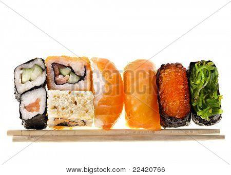 Japanese sushi food and chopsticks isolated