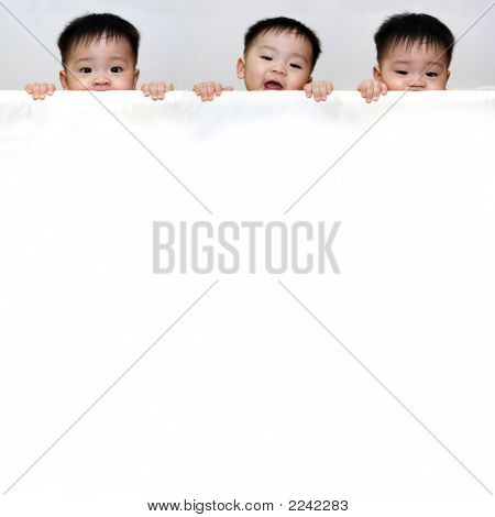 Three Boys With White Banner