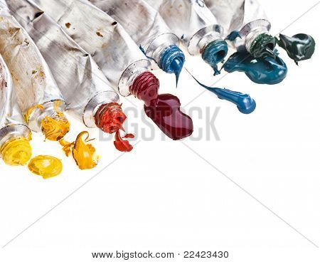 Tubes of colorful oil paint on white