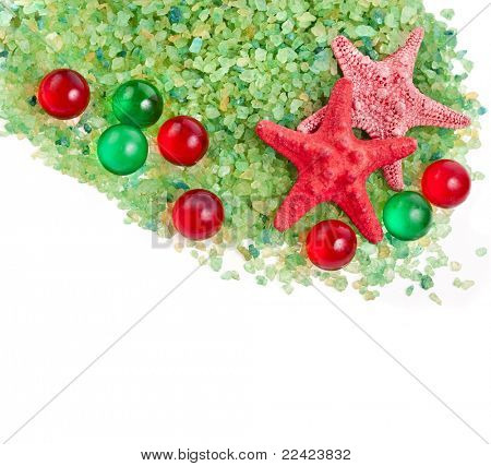 sea salt ,red starfish and bath aromatic balls isolated on white