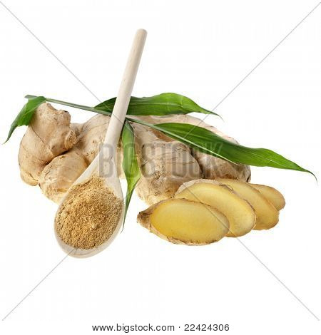 fresh ginger and powder in the wooden spoon