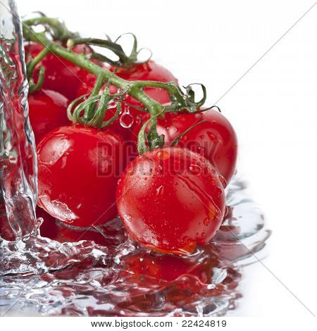 fresh  tomatoes with pouring water