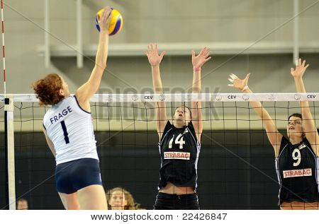 DEBRECEN, HUNGARY - JULY 9: Zsanett Miklai (in black 9) in action a CEV European League woman's volleyball game Hungary (black) vs Israel (white) on July 9, 2011 in Debrecen, Hungary.