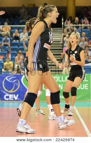 DEBRECEN, HUNGARY - JULY 9: Dora Horvath (C) celebrates at a CEV European League woman's volleyball game Hungary (black) vs Israel (white) on July 9, 2011 in Debrecen, Hungary.