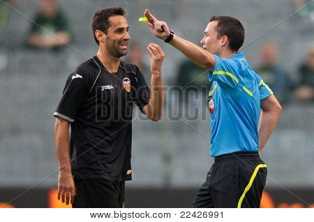 VIENNA,  AUSTRIA - JULY 26 Jonas Gonalves Oliveira (#7, Valencia) has as discussion with referee Harald Ruiss during the friendly soccer game on July 26, 2011 in Vienna, Austria. SK Rapid wins 4:1.