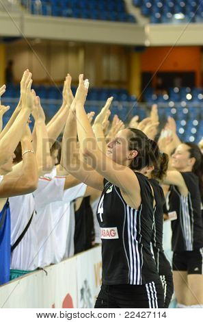 DEBRECEN, HUNGARY - JULY 9: Hungarian players celebrate at a CEV European League woman's volleyball game Hungary (black) vs Israel (white) on July 9, 2011 in Debrecen, Hungary.