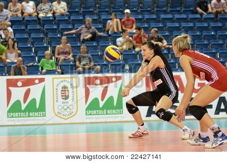 DEBRECEN, HUNGARY - JULY 9: Rita Liliom (in black) in action at a CEV European League woman's volleyball game Hungary (black) vs Israel (white) on July 9, 2011 in Debrecen, Hungary.