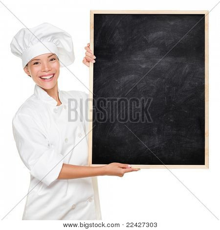 Chef. Woman cook showing empty menu chalkboard with copy space. Happy smiling Asian Caucasian female chef isolated on white background holding nice textured blackboard for advertising.