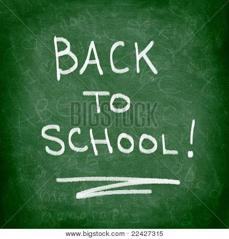 Back to school chalkboard. Green chalk blackboard written Back To School with white chalk. Nice texture.