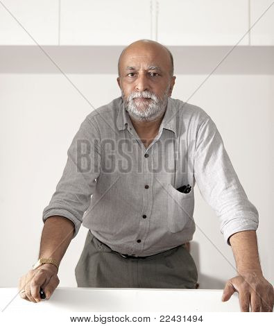Bearded Asian Man Looking Into Camera Lens