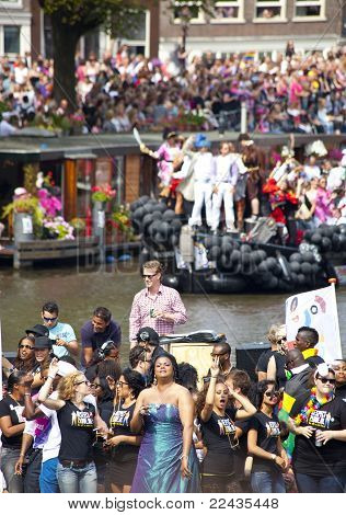 People Greeting From A Boat At Canal Parade At Gay Pride Weekend In Amsterdam