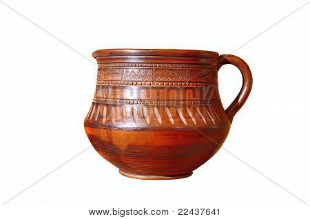Old decorative ceramic ewer isolated on white background