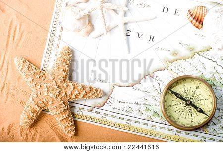 old map (Public domain - 1640 copyright expired) and compass on sand background