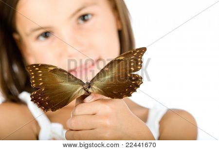 little girl holding a butterfly