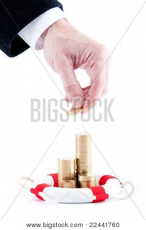 businessman hand with stacks of coins and lifebelt isolated on white background