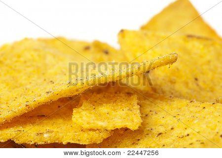 extreme closeup of a delicious nachos stack