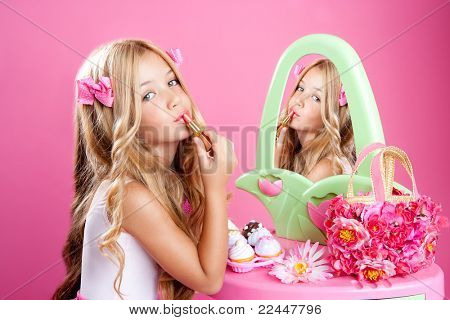 fashion little doll girl in pink vanity mirror with lipstick