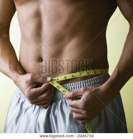 Bare Chested Man Measuring Waist