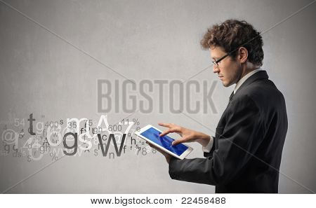 Young businessman writing on a tablet