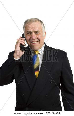 Older Businessman On Phone In Anguish
