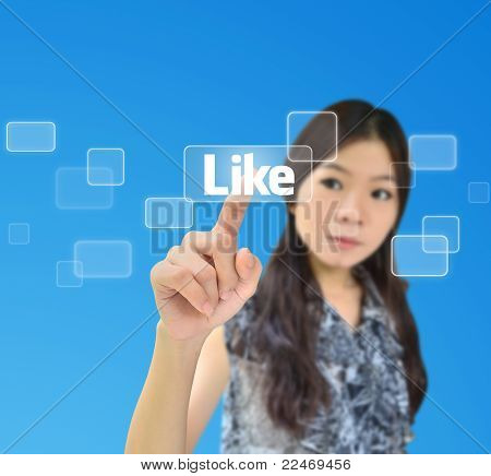 Portrait Of Asian Woman Pressing Like Button