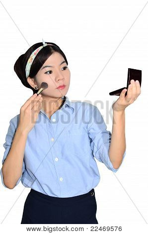 Portrait Of Asian Woman Applying Make Up