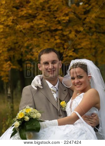 Just Married Portrait In Yellow Trees