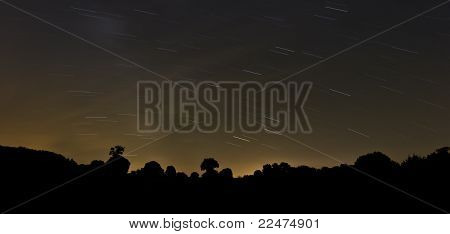 Long Exposure Photo Of Night Sky With Stars Trail