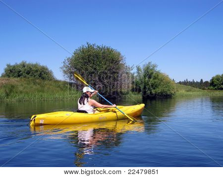 kayaker on a calm river