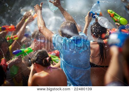 SAMARA,RUSSIA-JULY 24: young people shooting and throwing water at each other during Water Wars flashmob,July 24, 2011, Samara, Russia