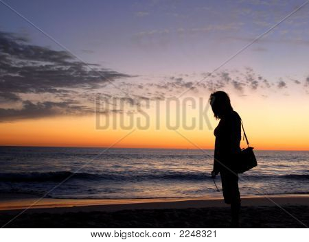 Womens Silhouette On The Beach