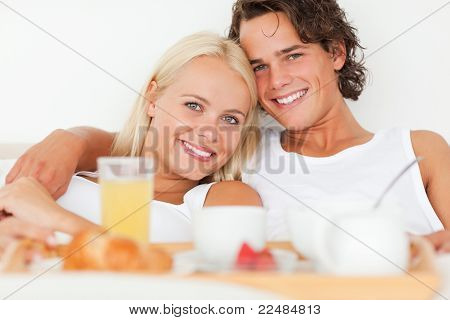 Close Up Of A Smiling Couple Having Breakfast