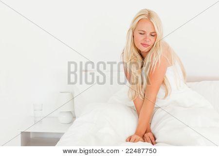 Blonde Woman Waking Up
