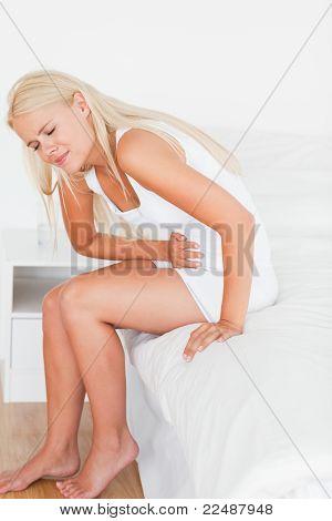 Portrait Of A Blonde Woman Having A Stomachache