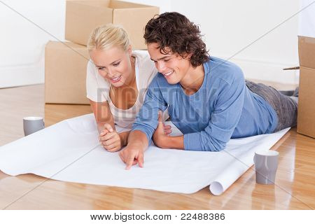 Young Couple Getting Ready To Move In A New House