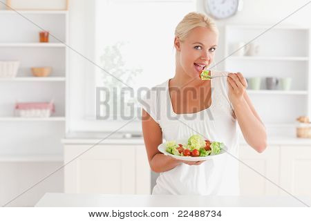 Blonde Woman Eating A Salad