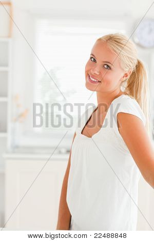 Woman Standing In Her Kitchen
