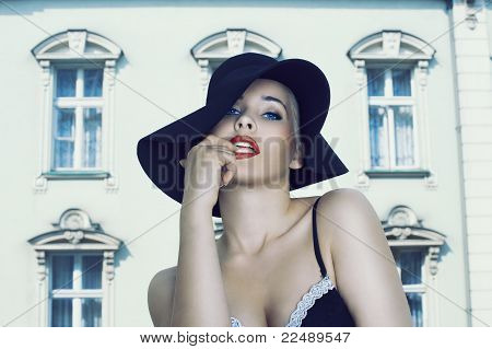 Glamour Beauty Wearing Black Hat And Bra Near The Palace
