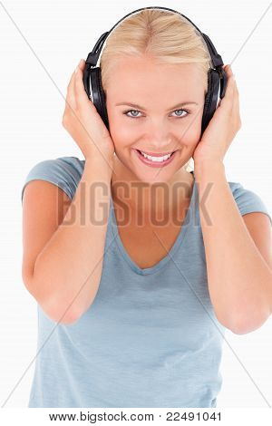 Close Up Of A Cute Woman With Headphones