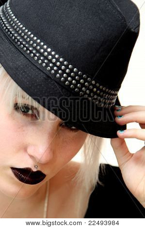 A Female Teenage Model Wearing Trilby Hat