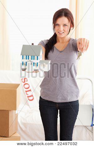 Portrait Of A Woman With Model House And Keys