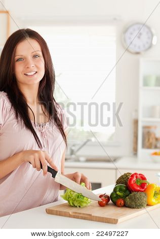 Smiling Woman Slicing Vegetabels