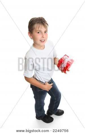 Boy With A Christmas Present Or Birthday Gift