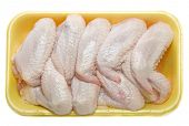stock photo of chicken wings  - raw chicken wings in a package isolated - JPG