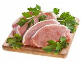 stock photo of pork cutlet  - meat pork with herb parsley isolated on white - JPG