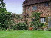 stock photo of english cottage garden  - Attractive old English cottage and rural garden  - JPG