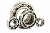 stock photo of bearings  - Four steel ball bearings on a white background - JPG