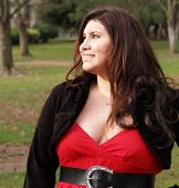 Plus-Size Woman In Red Dress Outdoors Portrait poster