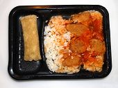 pic of frozen tv dinner  - Sweet sour chicken tv dinner with rice and chicken egg roll